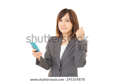 The woman having a smart phone