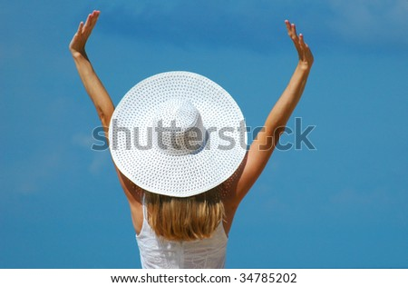 The woman in a white hat with the lifted hands