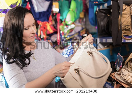 The woman in shop chooses purchase  - stock photo