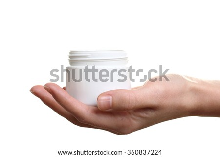 The woman is holding an outdoor moisturizer on white isolated background - stock photo
