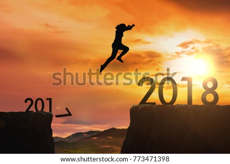 The woman jumping from 2017 cliff to 2018 cliff on sunrise time : meaning to going to year 2018