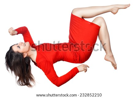 The woman laughs and flies or falls on a white background. - stock photo