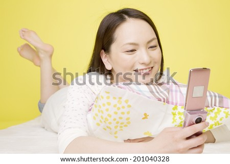 The woman looking at the mobile phone - stock photo