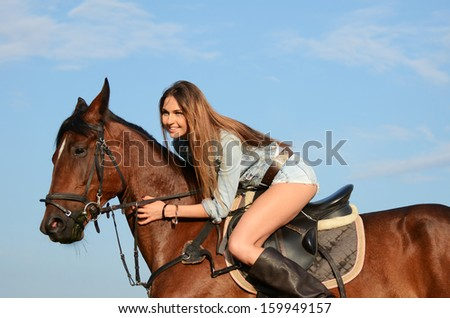 The woman on horse against the sky