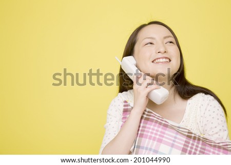 The woman on the phone - stock photo