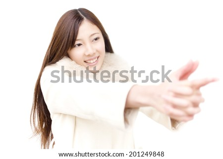 The woman pointing with her finger to the aim