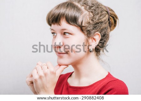 The woman prays. On a gray background. - stock photo