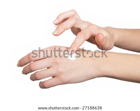 The woman rubs to itself in a hand cosmetic means for a white background