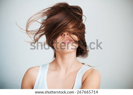 The woman's face half closed by hair. - stock photo