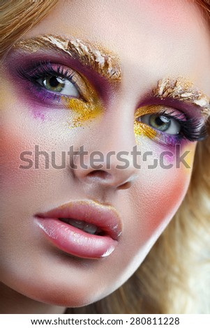 The woman's face with a luxurious make-up close-up - stock photo