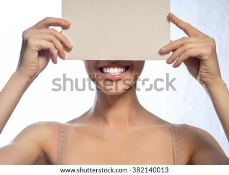 The woman's face with beautiful teeth, smile and positive advertising card
