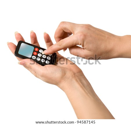 the woman's hand pressed the remote control isolated
