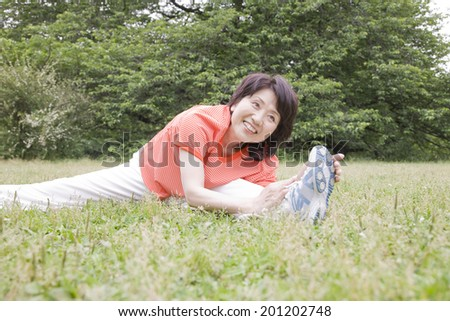 The woman stretching in the park
