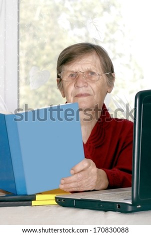 The woman studies the computer - stock photo