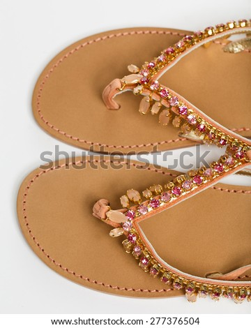 The woman summer sandals isolated on a white background