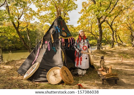 The woman the shaman will execute a ceremony - causes spirit of water... - stock photo