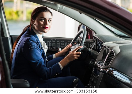 The woman the steering wheel of the car.Test Drive - stock photo