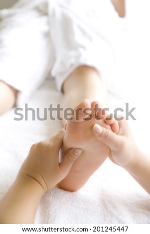 The woman undergoing foot massage