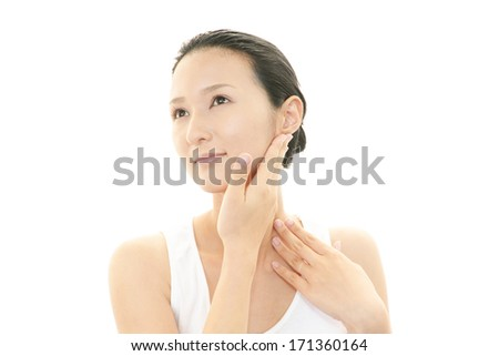 The woman who is doing skin care. - stock photo