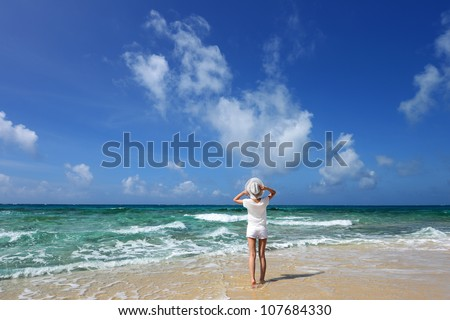 The woman who relaxes on the beach. - stock photo