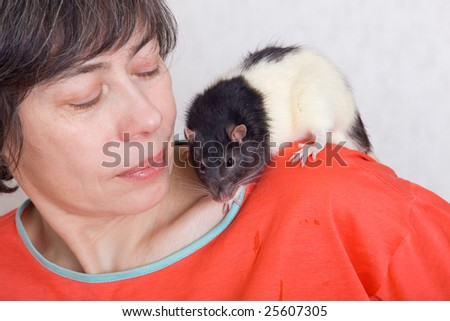 The woman with a black-and-white rat on her shoulder