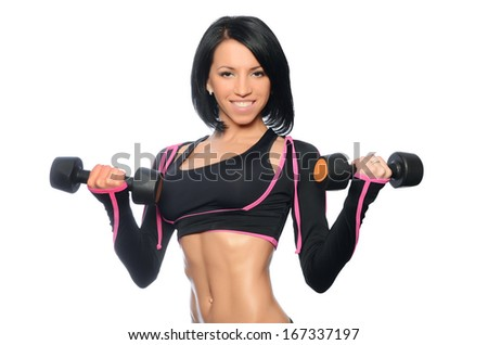 The woman with beautiful body with dumbbells