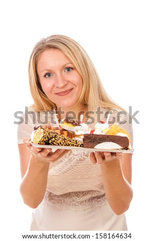 the woman with cakes in a hand was photographed on a white background