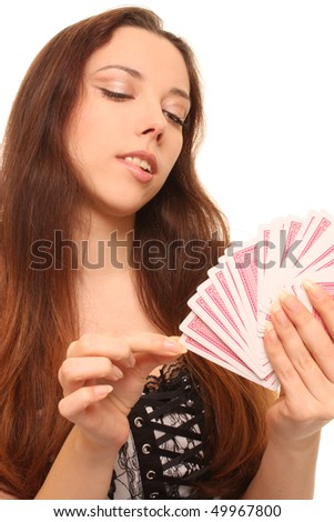 The woman with playing cards - stock photo