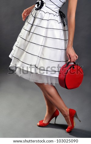 The woman with red accessories in studio - stock photo