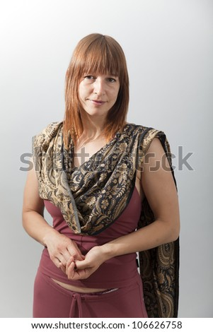 The woman with shawl on the gray background - stock photo