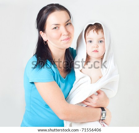 The woman with the child in a towel, a white background