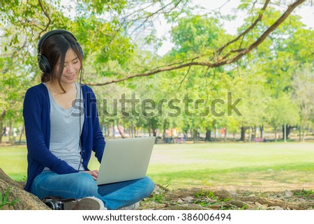 The woman working in the park with laptop.