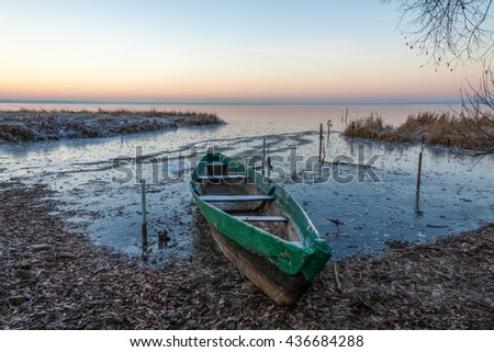 The wooden boat was managed to be pulled out from ice captivity, otherwise it would be crushed. - stock photo