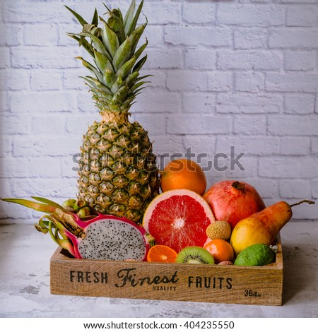 The wooden box with different fruit - stock photo