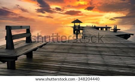 The wooden bridge extending into the sea.  - stock photo