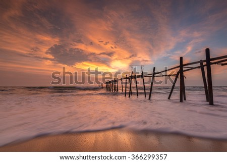 The wooden bridge in the sea evening