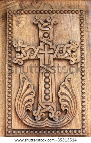 The wooden door to apostolic church, Armenia - stock photo