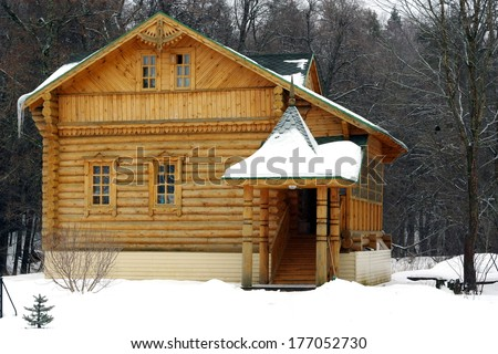 The wooden house in winter. Russia - stock photo
