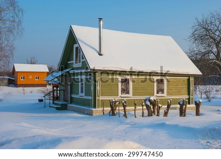 The wooden house on a snowy street in the village