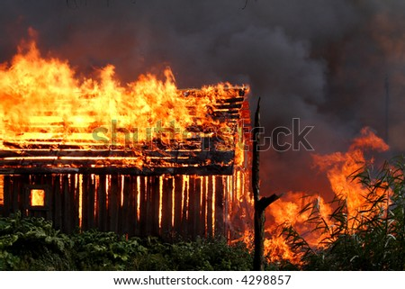 The wooden house on fire