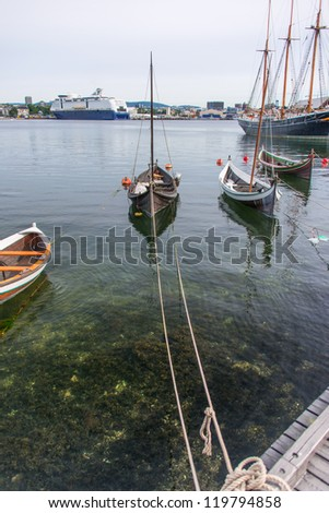 The wooden rowing and sailing boats - stock photo