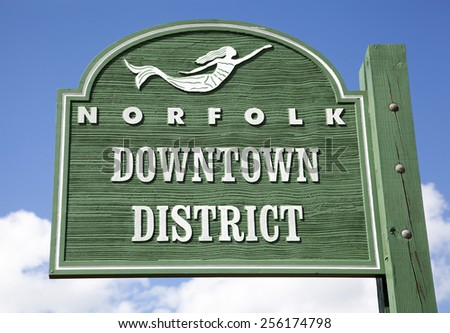 The wooden sign showing the beginning of Norfolk downtown (West Virginia). - stock photo