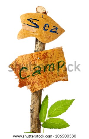 The wooden signs determining a place of camp and a direction to sea - stock photo