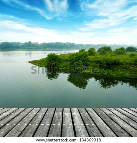The wooden structure of the small river Platform - stock photo