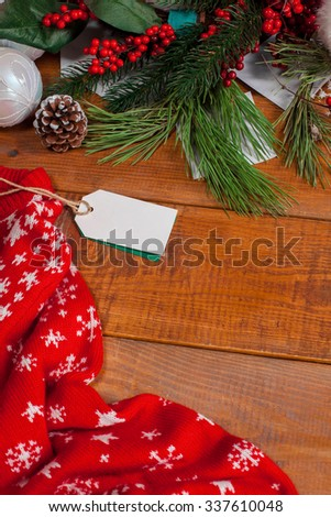 The wooden table with a empty  blank price tag and Christmas decorations. Christmas mockup concept