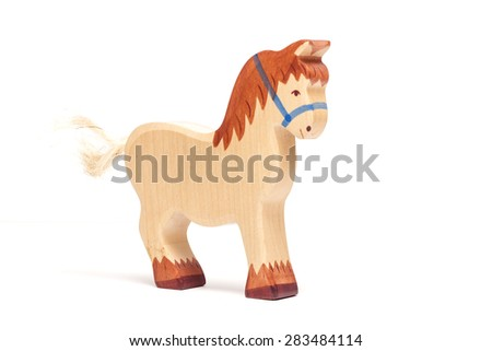 The wooden toy of horse for kids isolated white background at the studio.