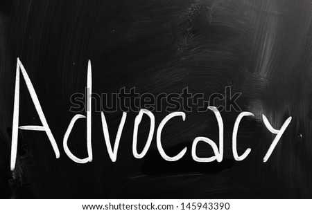 The word 'Advocacy' handwritten with white chalk on a blackboard