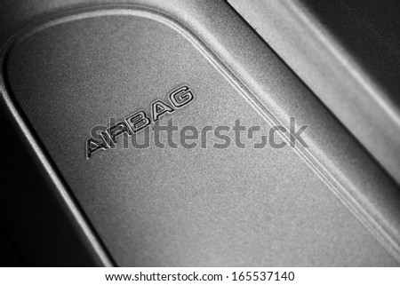 "The word ""Airbag"" is written on a car's dashboard - stock photo"