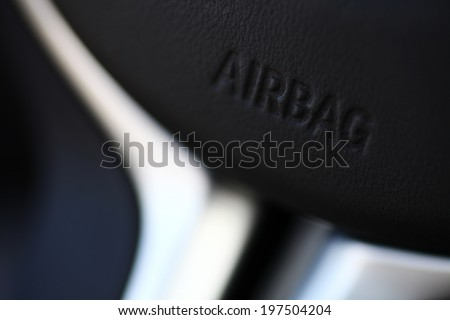 "The word ""Airbag"" is written on a car's steering wheel. - stock photo"