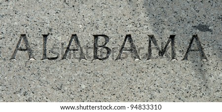 "The word ""Alabama"" carved into granite"